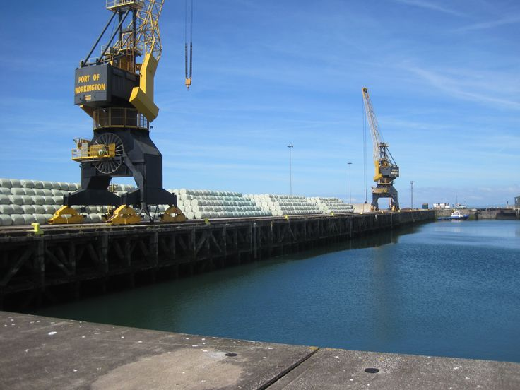 Port of Workington: The Nelcon portal cranes and bags of Solid Recycled Fuel; the pilot boat Derwent is in the dock. Photo by Ann Lingard, from Solway Shore Stories.