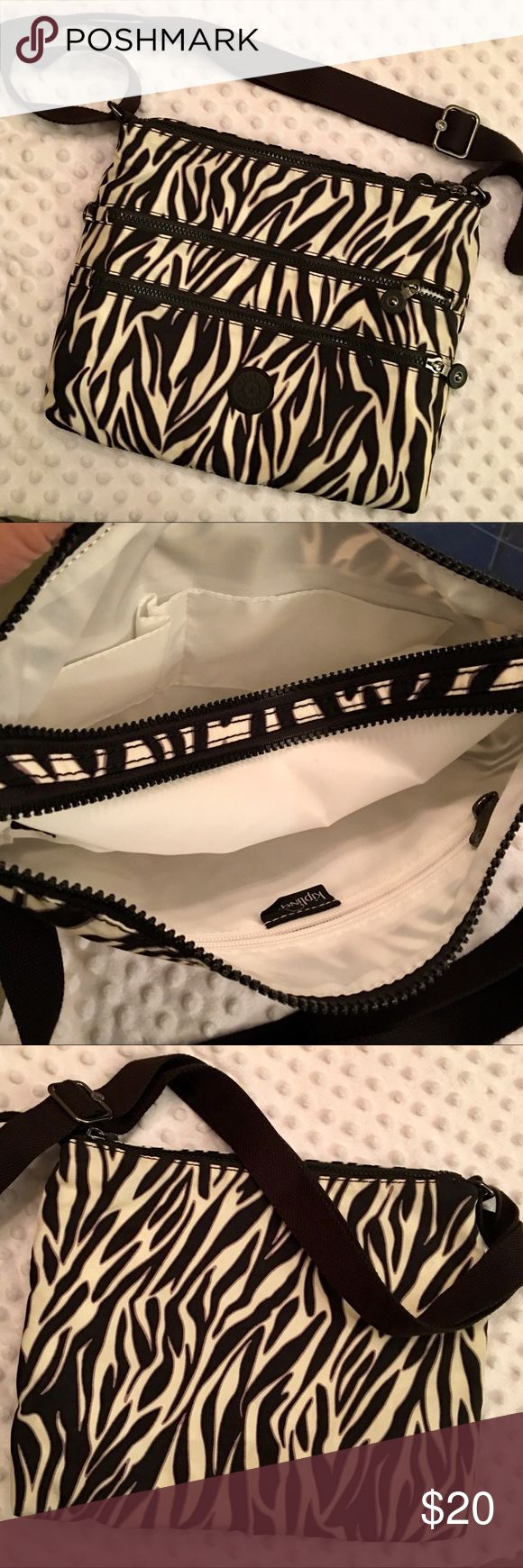 """KIPLING Alvar Crossbody Messenger Handbag 👜! NWOT! KIPLING Alvar Crossbody Messenger Bag! Used only once, & it's in like-new condition. 5 total zippered pockets - 2 in front 2 on top, 1 inside, I purchased this NEW from Amazon, but didn't like the pattern. Missed the return window. This Crossbody is the PERFECT size. I have a number of them in different colors/patterns.  Drop Length 24"""" Adjustable Shoulder Strap Missing monkey keychain. Kipling Bags Crossbody Bags"""