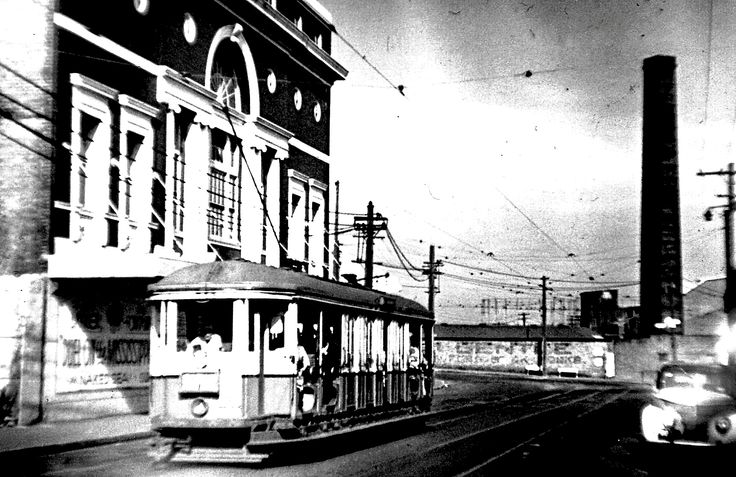 Sydney O class tram car, passing St. Peter's picture theatre. 1958.