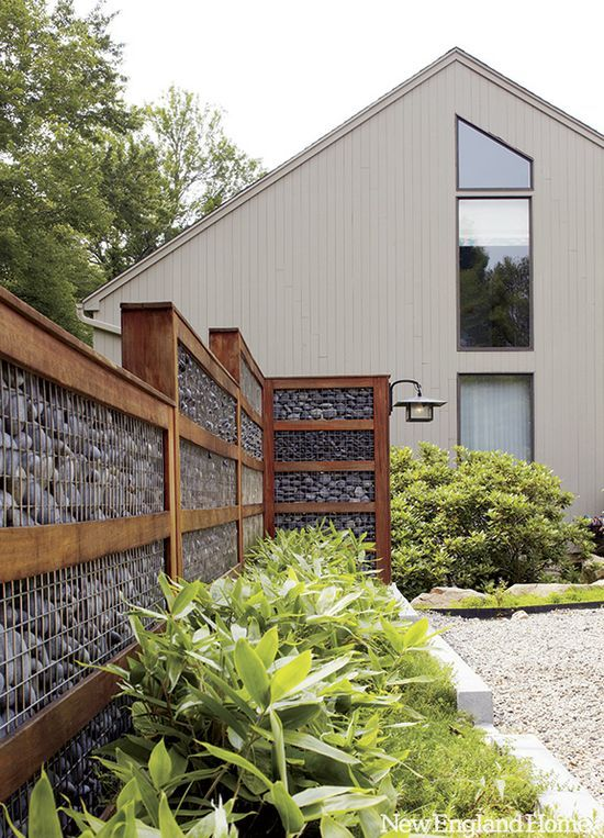 A gabion wall with a difference. The edging gives it definition.