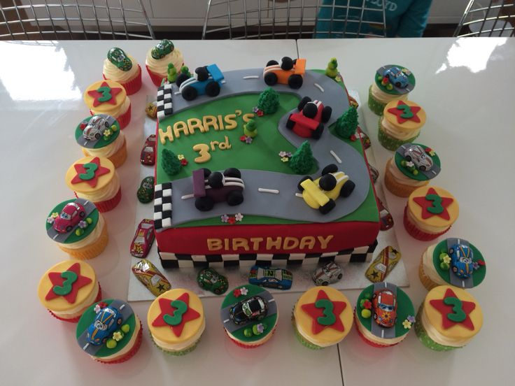 Dinky Cars Birthday Cake for a handsome little 3 year old! Definitely one of my favourite cakes simply because I thoroughly enjoyed making it!!!  Chocolate cake with choc hazelnut cream filling and  vanilla cupcakes with  chocolate buttercream! #boysbirthday #boycake #birthdaycake #racecars #cars #dinky #chocolatecake #vanillacupcakes
