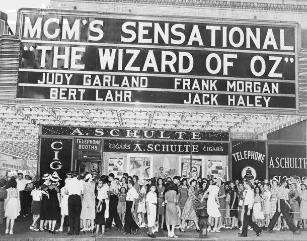 Pictured in front of the Capitol Theater on Broadway is part of the crowd of 10,000, mostly women and children, who surrounded the entire block to wait in line for the opening performance of the film The Wizard of Oz. 1939.