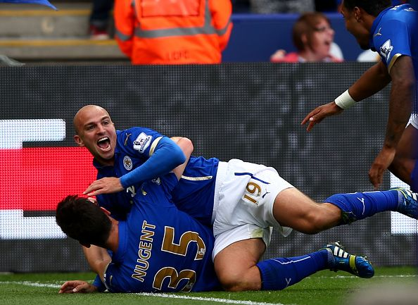 Esteban Cambiasso of Leicester City celebrates with David Nugent of Leicester City after scoring his team's third goal during the Barclays Premier League match between Leicester City and Manchester United at The King Power Stadium on September 21, 2014 in Leicester, England. (