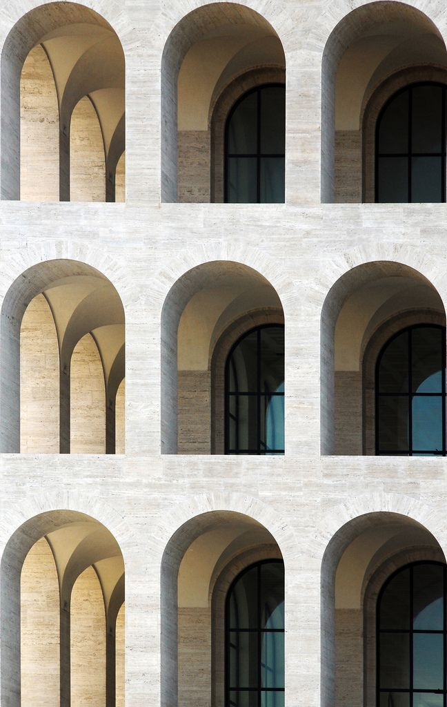 The Palazzo della Civiltà Italiana was constructed as part of the program of the Esposizione Universale Roma, a large business center and suburban complex, initiated in 1935 by Benito Mussolini for the planned 1942 world exhibition and as a symbol of fascism for the world. The Palazzo was designed by the architects Giovanni Guerrini, Ernesto Bruno La Padula and Mario Romano and constructed between 1938 and 1943.