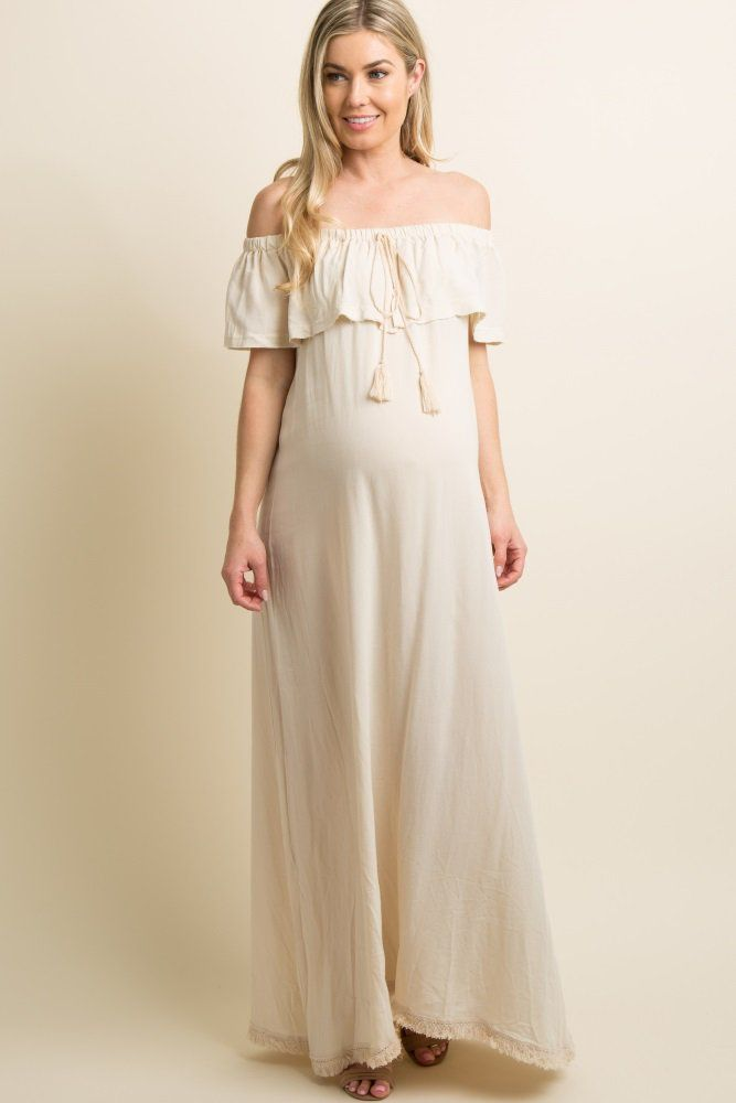 68497c24d A solid hued linen maternity maxi dress featuring a cinched off shoulder  neckline with a slit