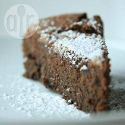 1 1/2 cups dark chocolate chips 570g chick peas (about 1 1/2 tins, drained) 4 eggs 3/4 cup (185g) white sugar 1/2 teaspoon baking powder 1 tablespoon icing sugar for dusting