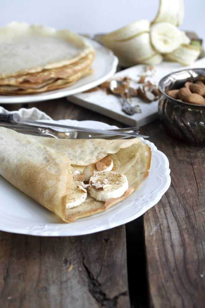 Grain, sugar and gluten free crepes topped with banana, almonds and cinnamon