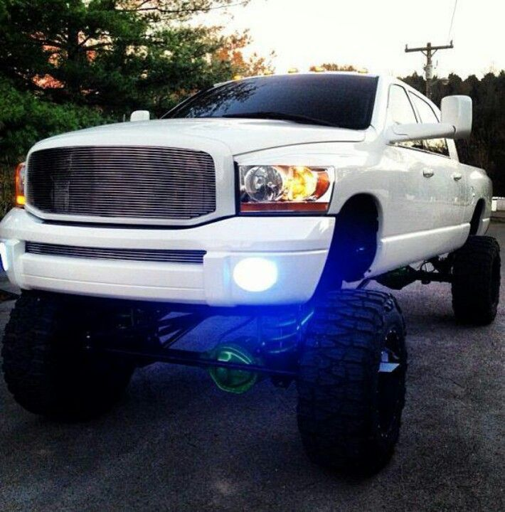 Thing of beauty and a joy forever. White lifted Cummins Dodge mud tires... nice. Off Road Wheel Package   www.dieseltees.com #dieseltees #cummins #offroadtruck