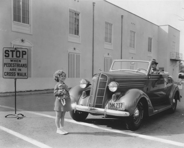 "Shirley Temple Don't run over the sunshine of the depression! President Franklin D. Roosevelt called Shirley ""Little Miss Miracle"" for raising the public's morale during times of economic hardship, even going so far as to say, ""As long as our country has Shirley Temple, we will be all right."" Wonder if this was taken on the studio lot?"
