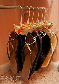 Great use for those old wire hangers...and you won't lose any more flip flops!