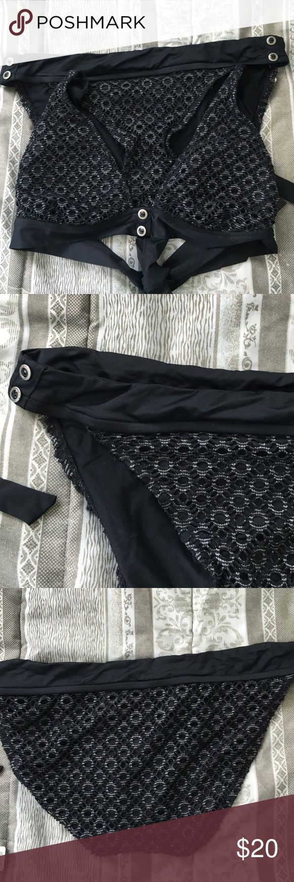 Black with silver bikini set Never used with tag bikini set in large top and bottom  from the brand bison bisou.  Top is a tie strap style and the material is a lace/ crochet type.  Doing a closet clean out. Swim Bikinis