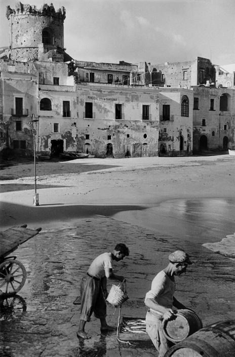 On the beach at forio ischia italy 1952 by henri cartier bresson