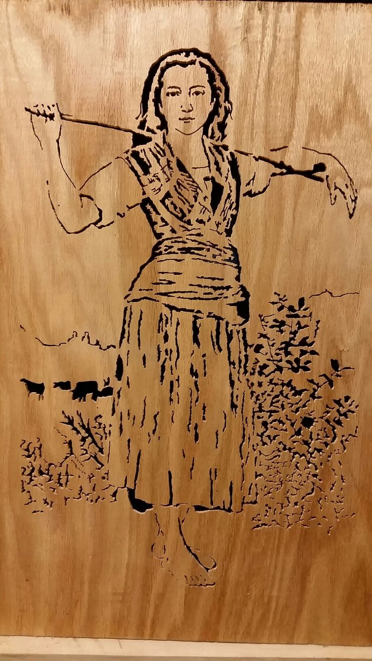 """The Shepherdess scroll saw portrait.   I wanted to post this to show that even some of the entry, beginner 16"""" scroll saws can be used to create amazing work.  This was made with a Craftsman 16"""" scroll saw that can take pin and plain end blades.  Over all it measure 29"""" tall by 19"""" wide.  If you want to learn to scroll saw, and cant afford expensive machines.  Get what you can and go from there."""