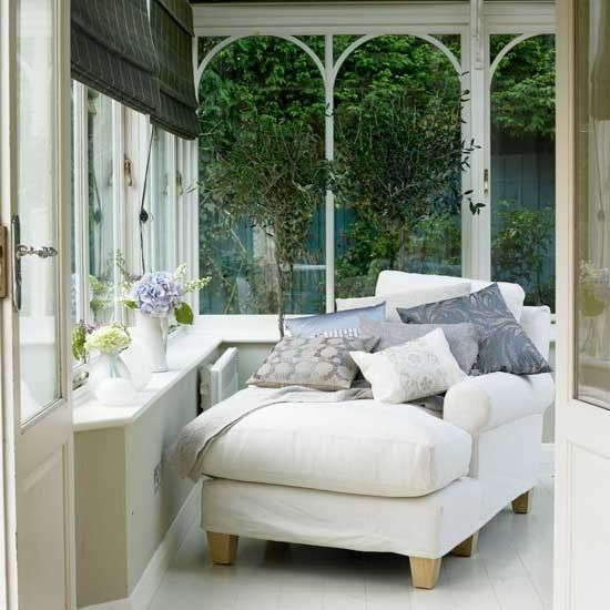 Even if there is only room for one comfy chair, make the  conservatory your go-to relaxation space.