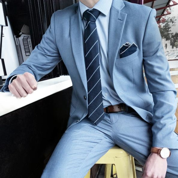 Striped tie and light blue suit.