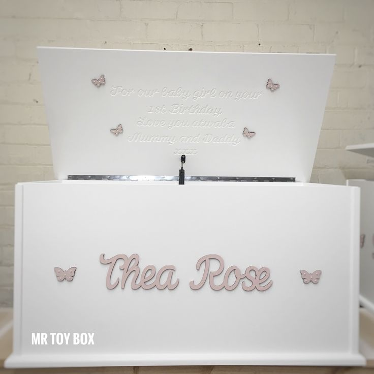 Stunning Cotton White Toy Box for Thea Roses 1st Birthday. The butterflies under the lid are so cute!! #toybox #toychest #toystorage #personalisedgifts #blanketbox #firstbirthday