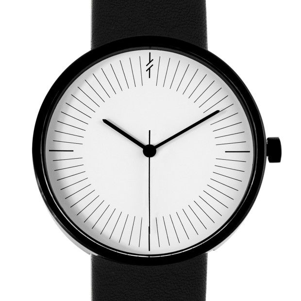 The Simpl Monochrome's minimal white dial features a numberless index; two bold hands denote the hours and minutes and a delicate hand denotes the seconds. #design #watches
