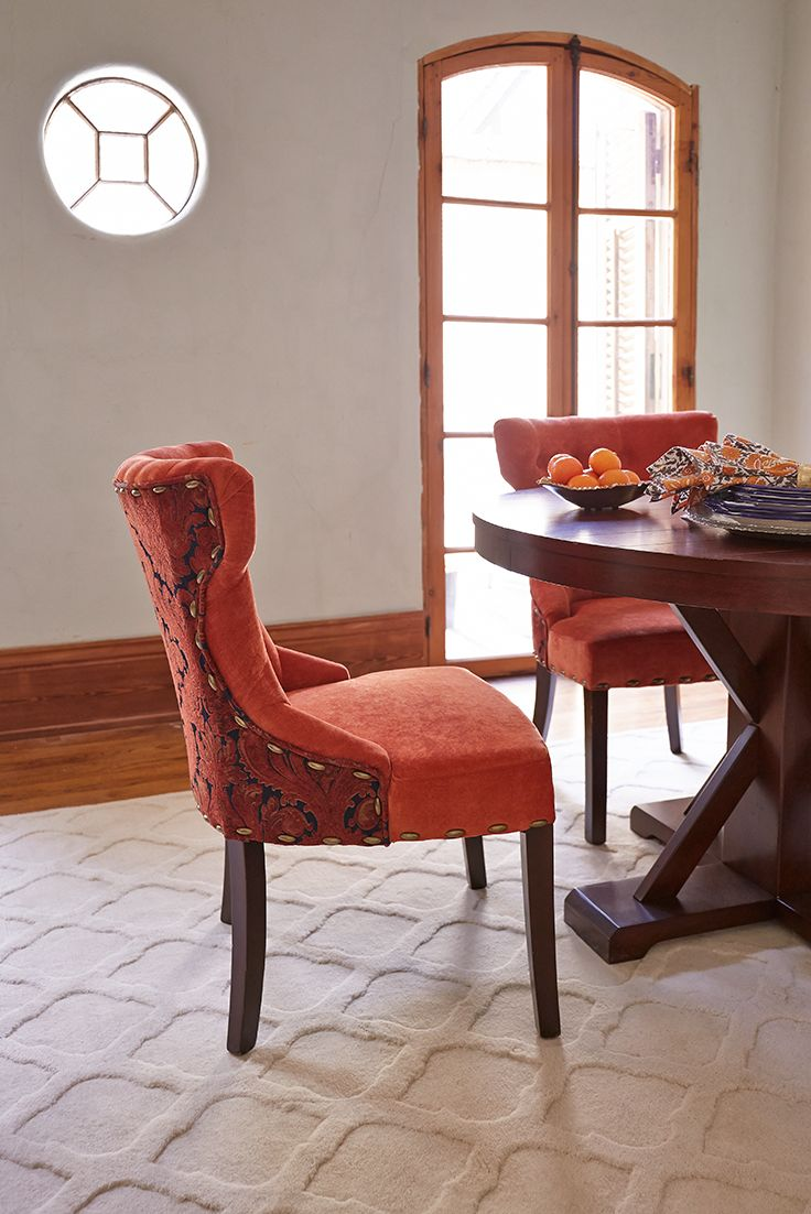 Orange damask chair - Pier 1 S Hourglass Dining Chair Is Upholstered And Tufted Entirely By Hand In Velvety Orange Polyester On Front And Ornate Damask