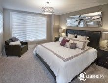 Master bedroom. Dark furniture, decorative mirrors, light bedding. | The Intrigue model, by Kimberley Homes, Edmonton, AB #interiordesign #newhomedesign #homedesign #newhome #customhome #yegre #buildwithkimberley #kimberleyhomes #bedroominspo #bedroomideas #bedroom #masterbedroom