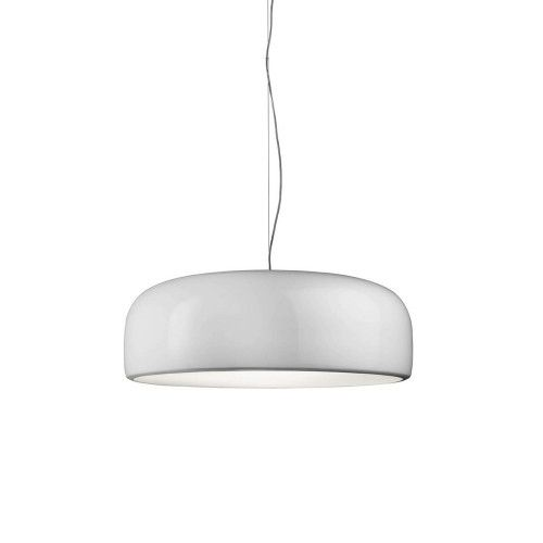 The interior of the body is cast with an injection-molded opalescent polycarbonate diffuser, which creates an almost absorbent, soft quality to the lamp's interior