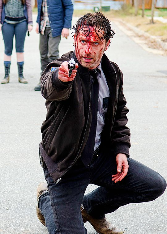 Rick lets his crazy peek out... I loved it and cheered him on. Dammit Michonne. TWD season 5.