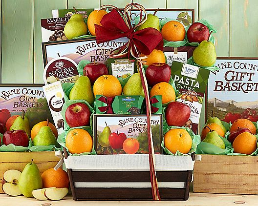 """Deluxe Fruit and Favorites: """"This deluxe fruit basket has 17 pieces of fruit and a mix of Wine Country favorites. Seven juicy oranges, five…"""