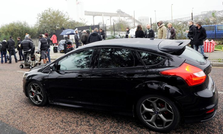"""Movie: The Sweeney (2012). pre-production Ford Focus ST (conventional Focus underneath) used by D.I. Jack Regan (played by Ray Winstone) of London Metropolitan Police Force """"Flying Squad"""". Based on the 70s UK TV show series of the same name."""