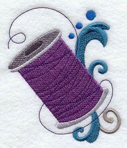 Катушка ниток и филигрань машинной вышивки дизайна.
