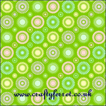 Free printable multi coloured on green spirelli flowers craft backing paper from www.craftyferret.co.uk