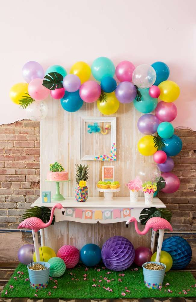 Amazing decorations at a flamingos and pineapples  birthday party! See more party ideas at CatchMyParty.com!