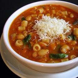 Pasta e Fagioli | This traditional pasta and white bean soup deserves the best Parmesan cheese you can afford. Use the rind to flavor the cooking liquid, along with onion, celery, carrot, ham, garlic, tomatoes, beef stock, thyme, bay leaf and pepper.