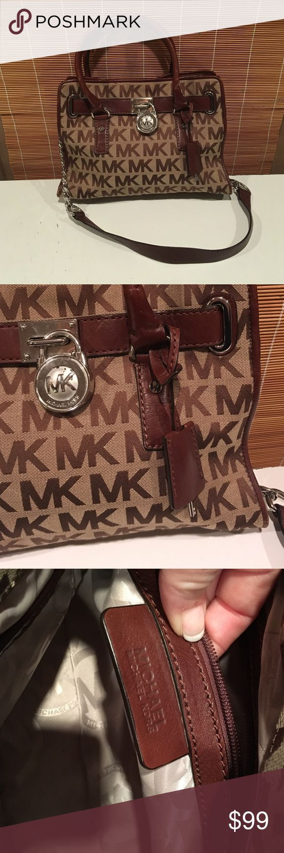 MK HAMILTON great condition Authentic Michael Coors Hamilton bag with silver hardware brown and tan. A little squished from being in the closet but in excellent condition and only used a couple of times. Has smaller leather handles and longer leather and silver chain strap for easy carrying. Michael Kors Bags Shoulder Bags