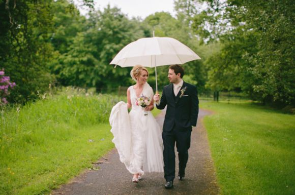 Since it very well could be raining on our April wedding day this would be a cute pic