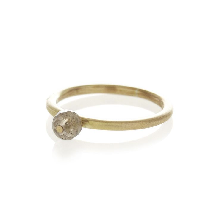 A brass ring with centered labordorite stone | dear rae