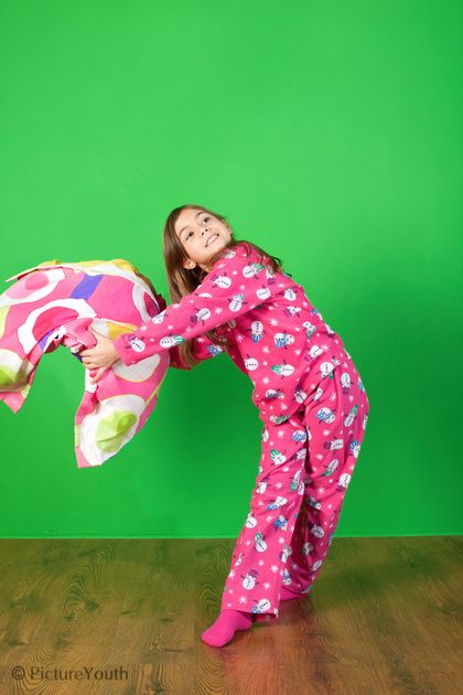 Child having fun with pillow in studio.  #custom photography  PictureYouth.com