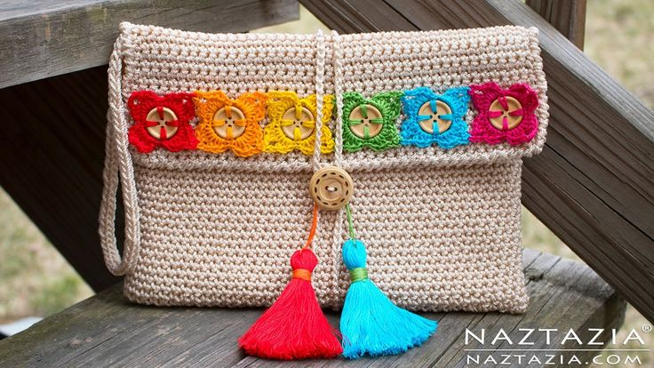 Donna Wolfe from Naztazia http://naztazia.com shows you how to crochet a bohemian style clutch evening bag with button flowers and tassels. This handbag is a...