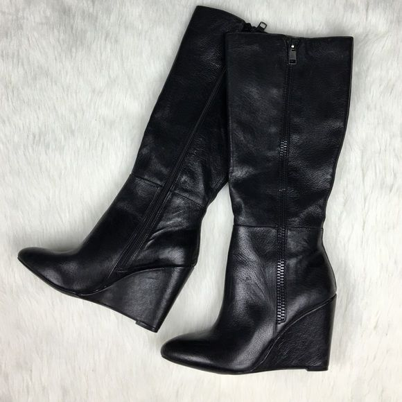 Steve Madden black leather wedge tall boots Brand new with the size sticker still on the heel. There is some minor shelf wear from the store that I tried to picture in the last 2 photos. So, priced accordingly. Awesome tall boots with the coolest zipper detailing. Michael Kors Shoes Winter & Rain Boots