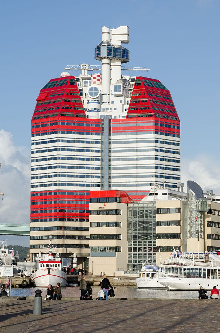 "Göteborg (Gothenburg) -- Skanskaskrapan standing in the area ""Lilla bommen"" (where the barque ""Viking"" is moored). The skyscrape was ready in 1989, built by Skanska, thereby its name (Skanska Scrape). It has 22 floors with offices and shops. The building is 86 meters high and visible from many parts of the city. Photo by Arild Vågen, Wikimedia."