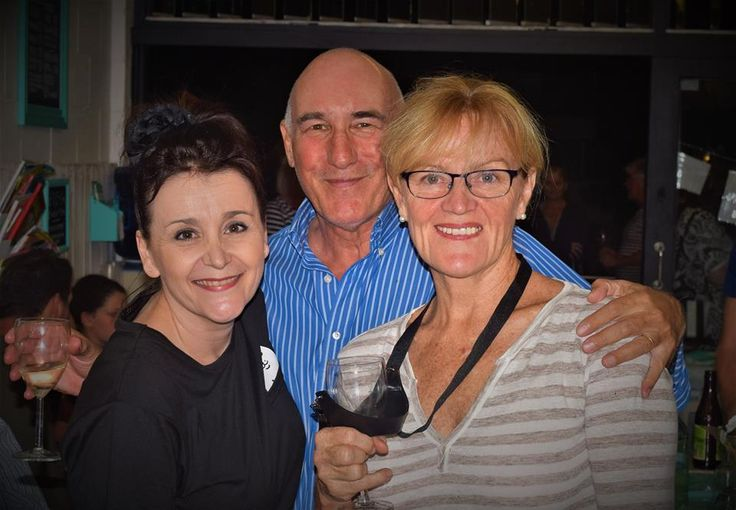 Owner Dominique with friends Kerry and Martin celebrating one year of woning Koala Park Laundromat in Burleigh Heads.