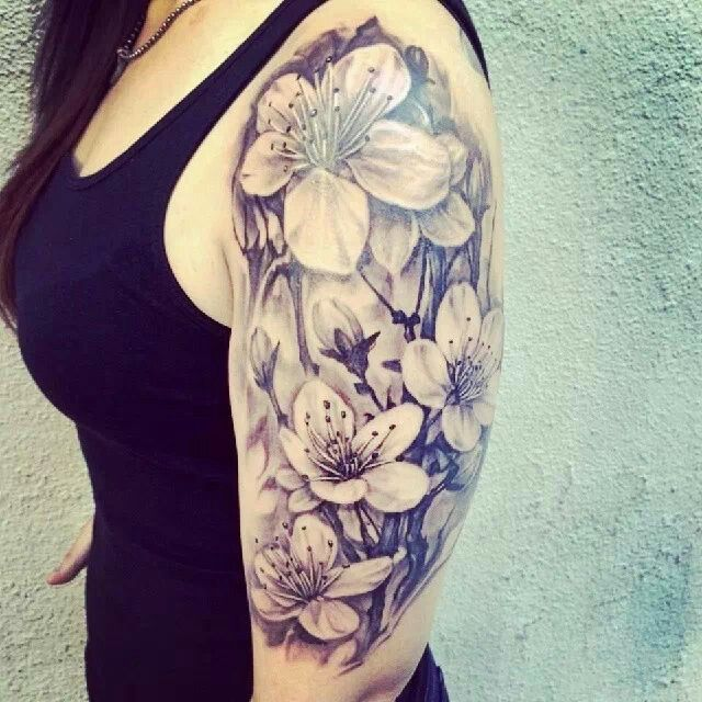 Half sleeve tattoo.  Flowers.