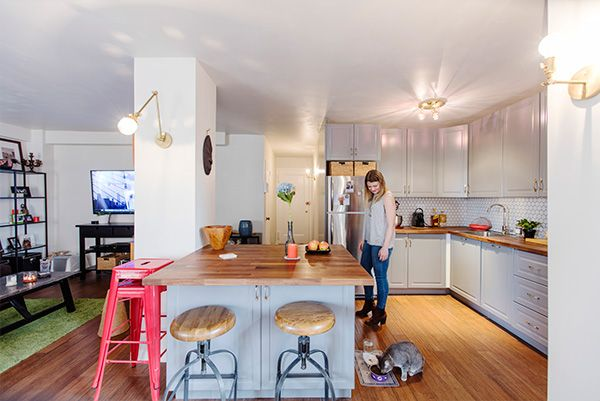 Clinton Hill kitchen remodel features a large island, which separates the kitchen from the living room, while offering bar seating, plenty of table space for entertaining, and hidden storage underneath.