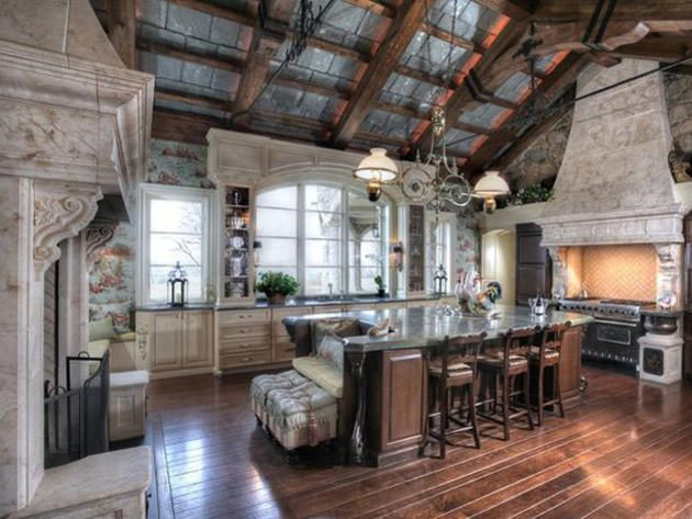 Great Hall style kitchen with marble hooded Fireplace and matching hooded gas range. Also of note are the exposed slate shingles at trussed ceiling...