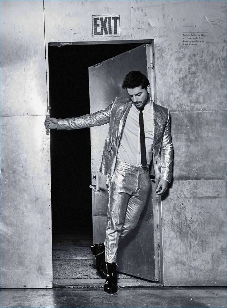 Making a statement, Maluma wears a metallic suit by Diesel with an AllSaints shirt and Saint Laurent boots.