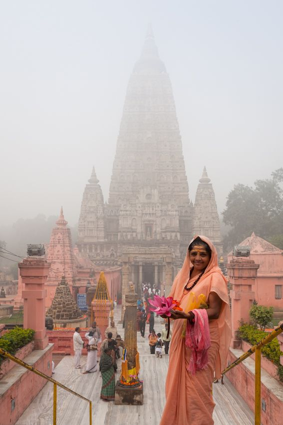"Bodh Gaya Pilgrim , India. The Mahabodhi Temple (महाबोधि मंदिर) (Literally: ""Great Awakening Temple""), a UNESCO World Heritage Site, is a Buddhist temple in Bodh Gaya, marking the location where Siddhartha Gautama, the Buddha, is said to have attained enlightenment. Bodh Gaya (located in Gaya district) is located about 96 km (60 mi) from Patna, Bihar state, India."