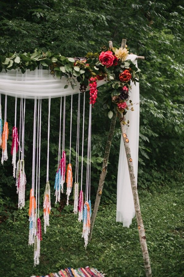 Handmade cord, fabric, and flower ceremony arbor | Image by The Colagrossis