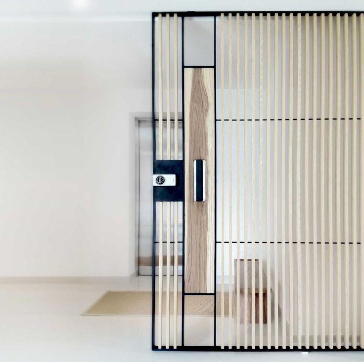 Steel-glass-wood door by 0932 Design consultants, Singapore.