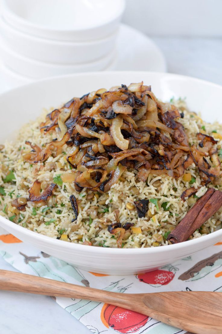 Mujadara is a Middle Eastern rice and lentils dish that is full of protein and fiber & naturally vegan & gluten free. You'll love the sweet and earthy flavor of this easy dish! #LetsLentil #LoveaLentil #ad