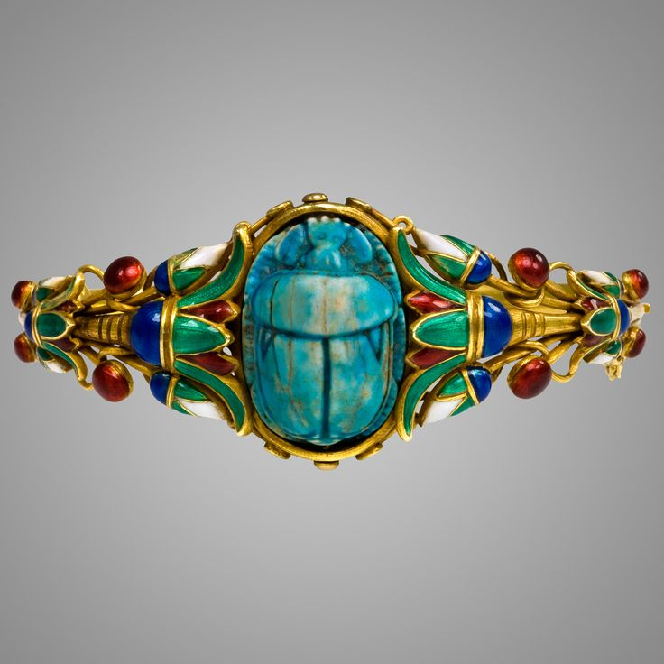 An Egyptian Revival Style Gold and Enamel Scarab Bracelet (1880)