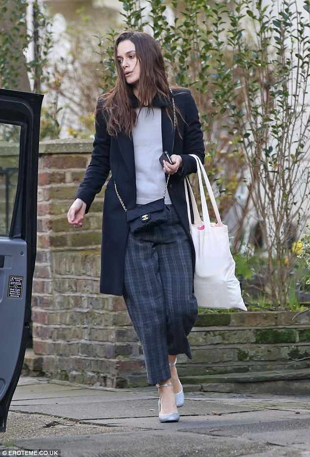 Casual chic: The actress, 31, looked completely relaxed in checked trousers by Toast as she got into a taxi with her partner and their sweet 22-month-old ahead of their family day out