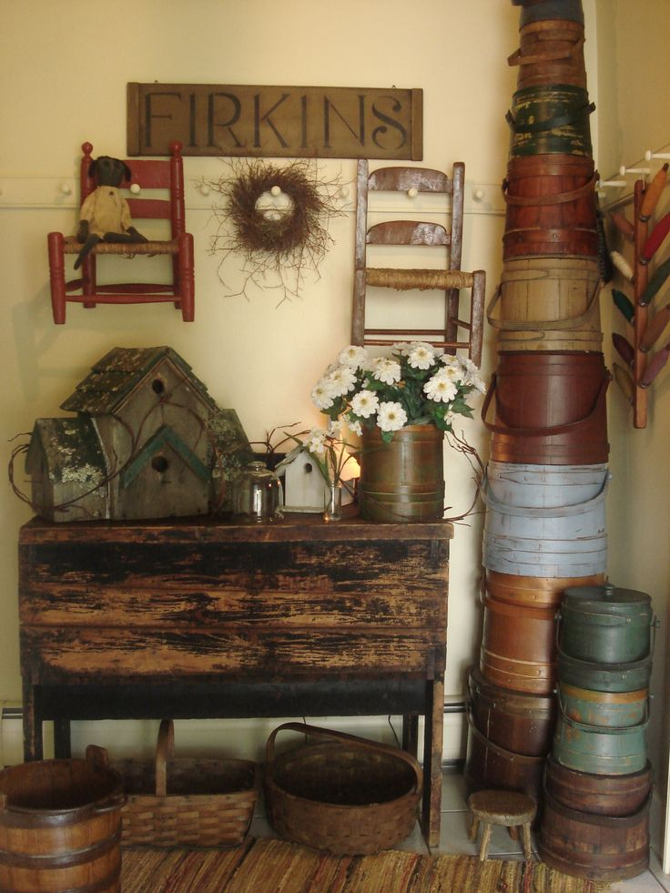 Prim Gathering...amazing collection of old firkins, baskets, & children's chairs.